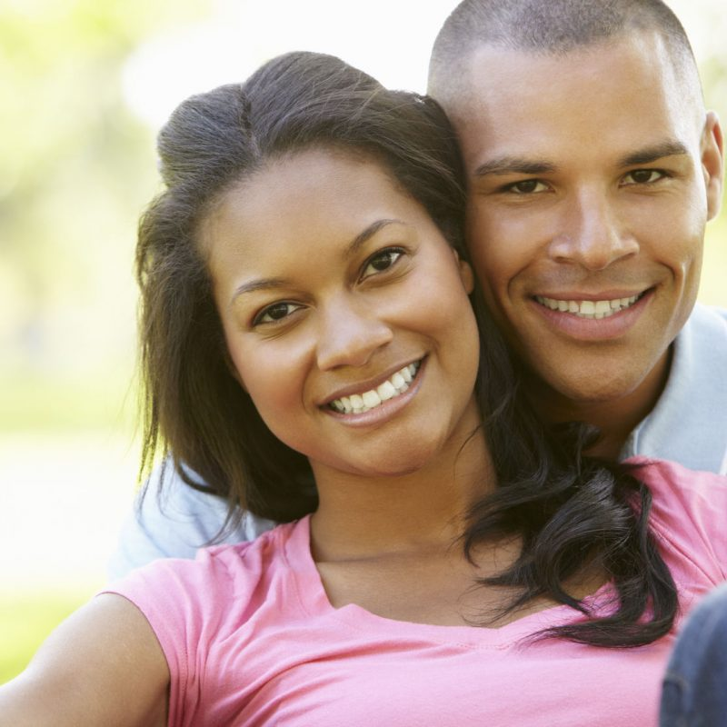 42109878 - portrait of romantic young african american couple in park